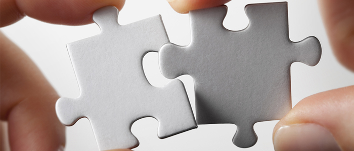 jigsaw pieces fitting together
