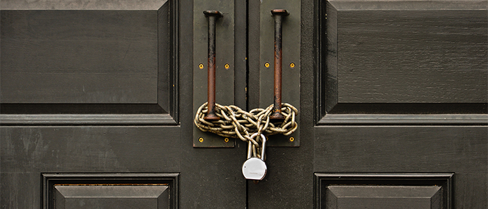 Padlocked wooden door