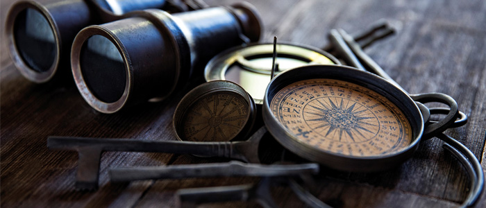 compass and binoculars