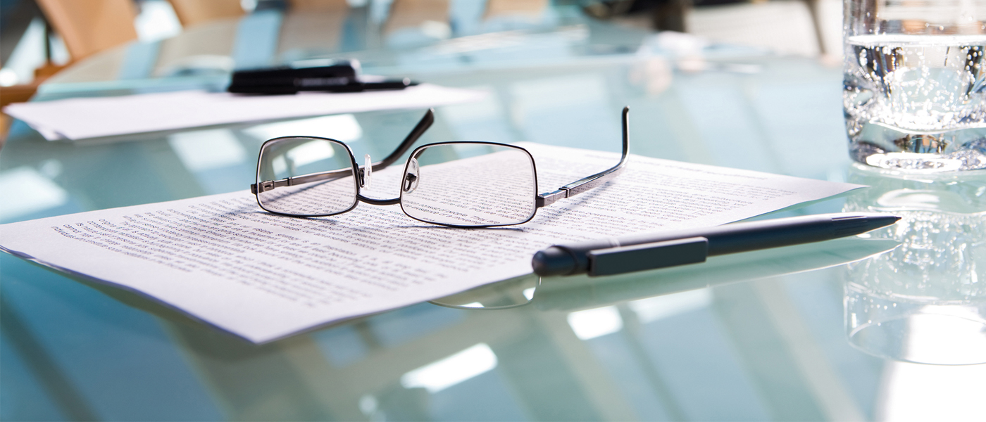 glasses on contract on table