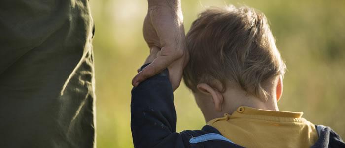 boy holding parent