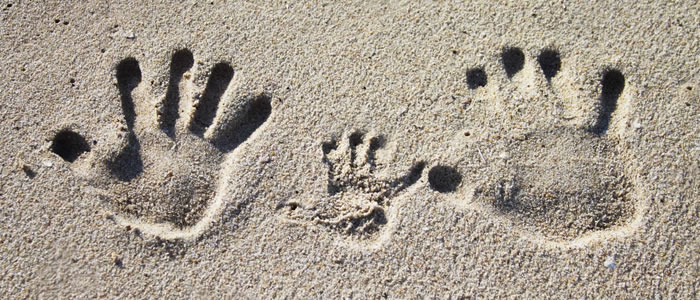 hand prints in the sand